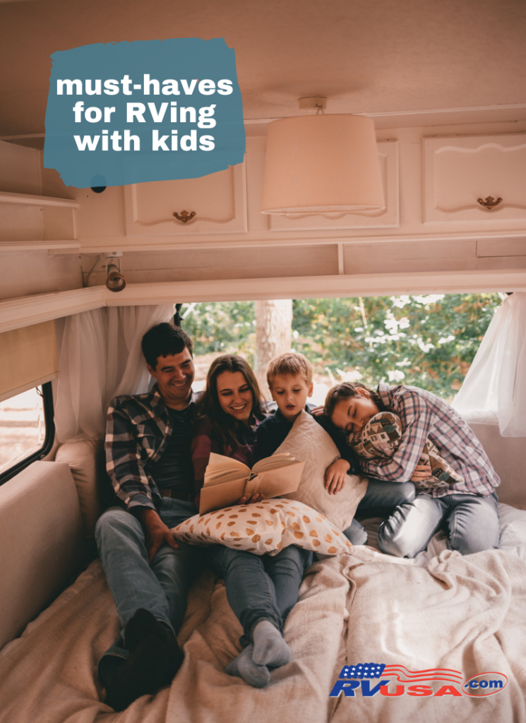 Family sits in RV with kids