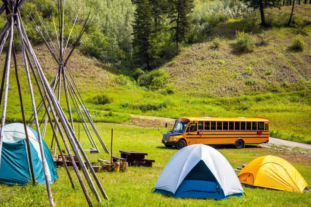 Skoolie camper at a campsite