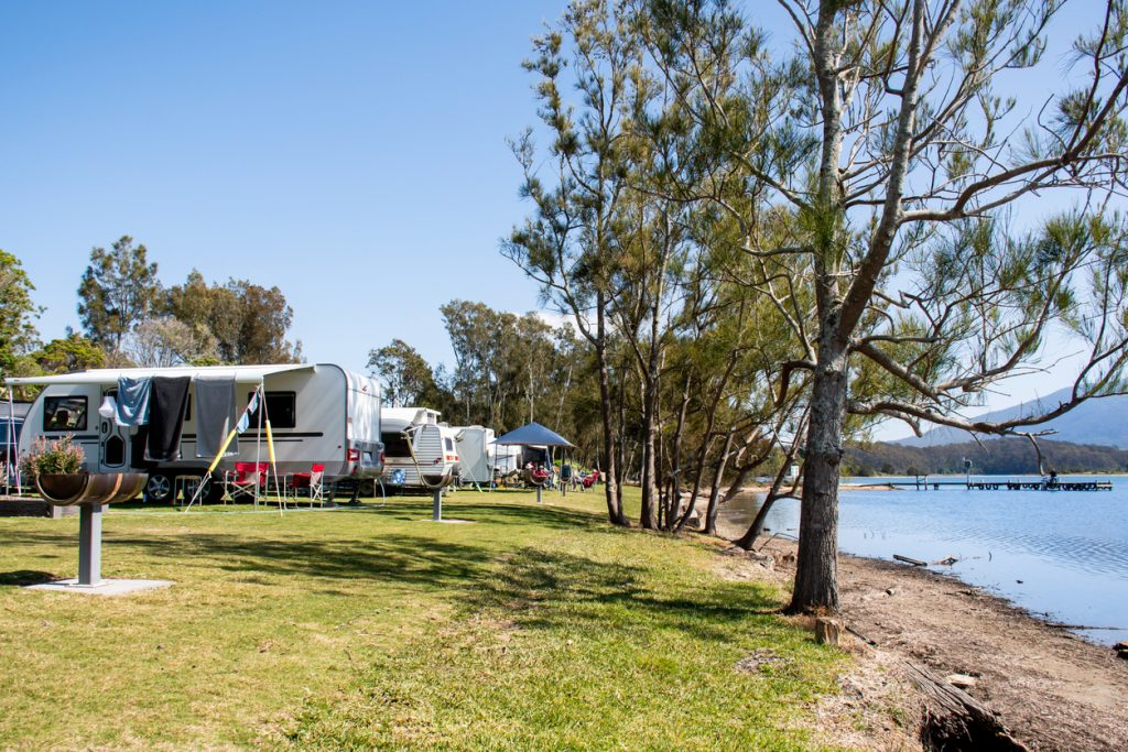 Travel trailers parked by a lake