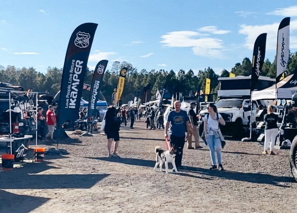 Event attendees stroll Overland Expo West